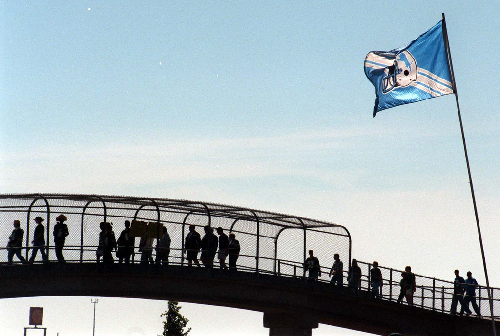 Description of . Football fans streem into the Pontiac Silverdome using the bridge over M-59 prior to the start of Sundays game against the Green Bay Packers. Lions won 23-15 over Green Bay.
