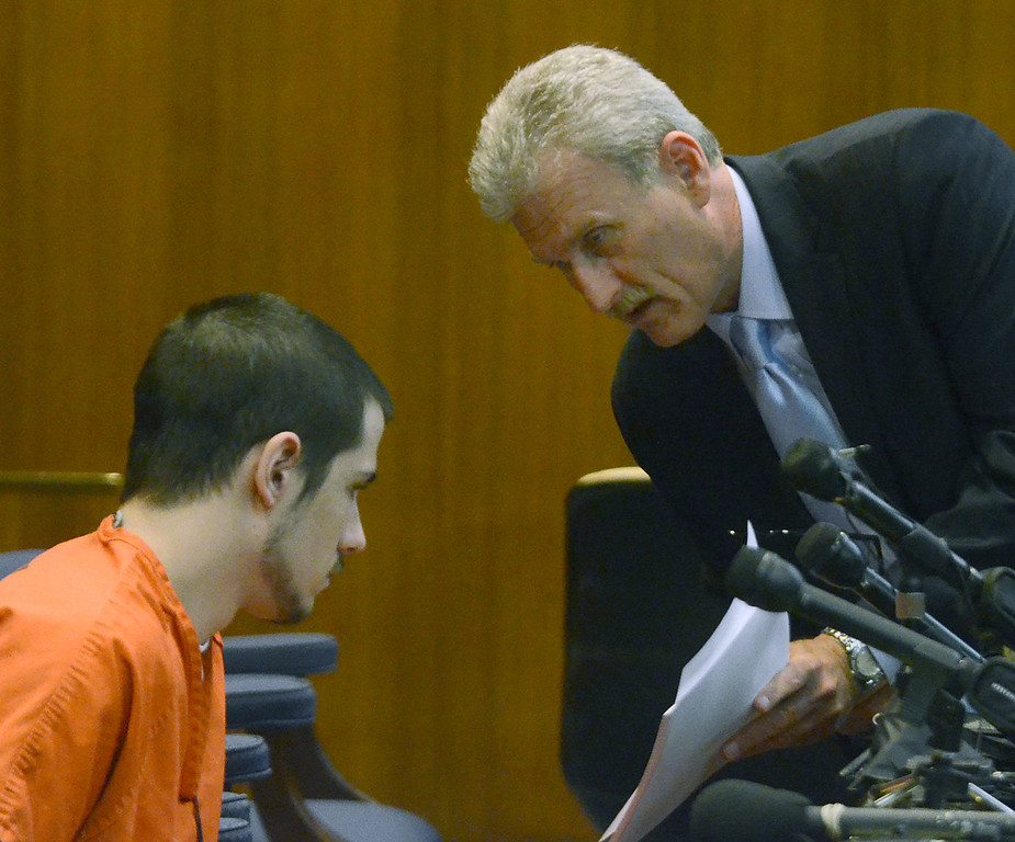 Description of . Tucker Cipriano (left) speaks with his attorney Mitchell Ribitwer before being sentenced to life with no parole for the beating death of his father Robert, in the courtroom of Oakland County Circuit Court Judge Shalina Kumar,  Wednesday July 24, 2013. (Oakland Press Photo:Vaughn Gurganian)