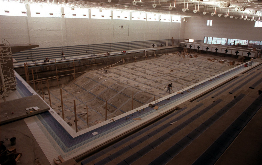 Description of . The pool under construction at the new sports arena/facility at Oakland University.