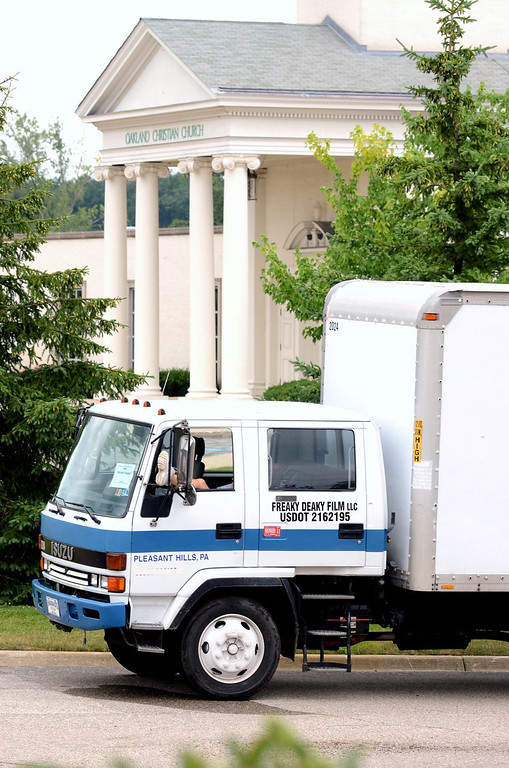 Description of . A production truck sits outside of Oakland Christan Church in Oakland Township.  Scenes for a movie named