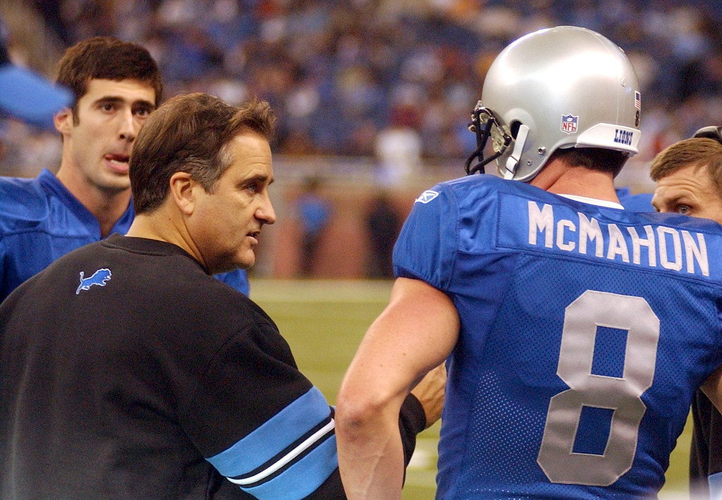. Detroit Lions head coach Steve Mariucci, center, sends in back-up QB Mike McMahon (9) as starter Joey Harrington,left, looks on during the Thanksgiving Day game played at Ford Field in downtown Detroit. Lions lost 41-9 to the Indianapolis Colts.