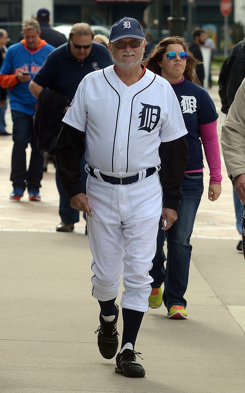 Description of . Gord Wright, of Essex, Ontario, looks like he's ready to play in his uniform before heading into Comerica Park for the start of Game 3 of the ALDS between the Tigers and Oakland A's, Monday October 7, 2013. (Oakland Press Photo:Vaughn Gurganian)