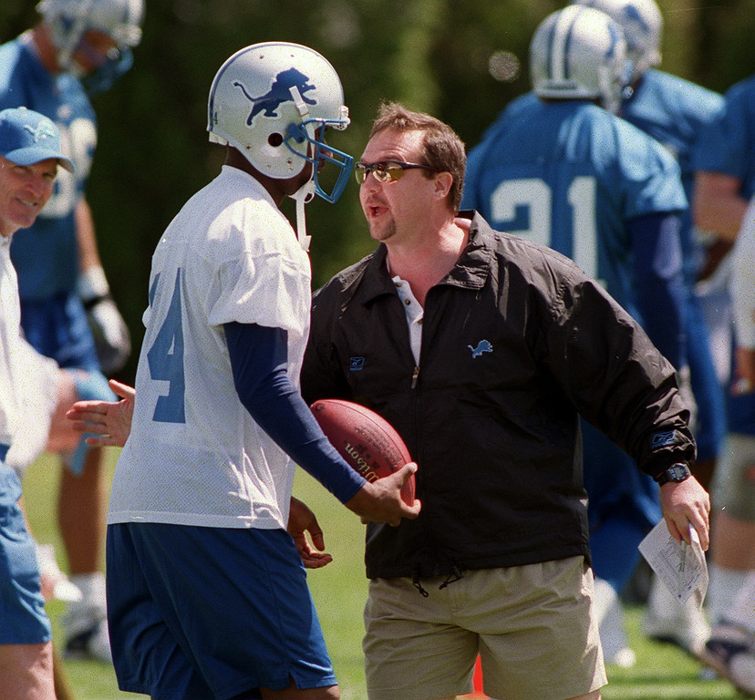 . Detroit Lions head coach Marty Mornhinweg, right, gets emotional with wide receiver Andre Rone (#14), during the Lions morning session of mini camp, Friday, April 27, 2001, at the Lions practice facility in Pontiac, Mich.