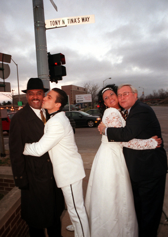 Description of . Hugging for a group photo outside of Baci Abraacci are (L-R): Pontiac Mayor Walter Moore; Kyril Evanoff; Jennifer Beth Kahn; and Oakland County Executive L. Brooks Patterson.  (Kyril plays the role of