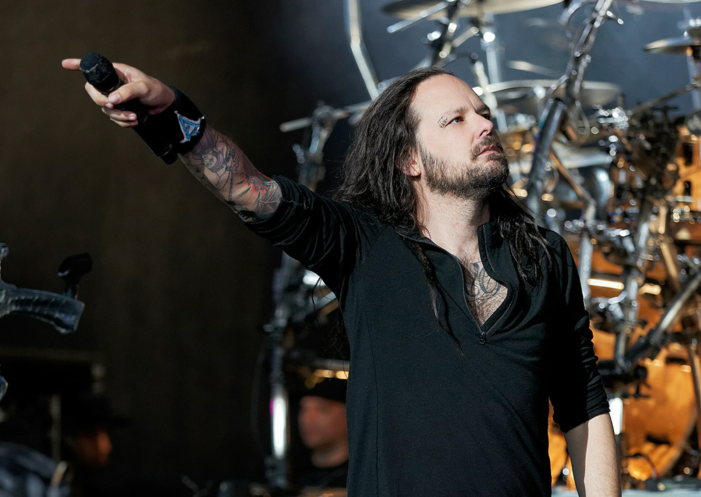 Description of . Korn's Jonathan Davis performs at Mayhem Festival on Thursday, July 18, 2014, at DTE Energy Theatre, Independence Township. Photo by Ken Settle
