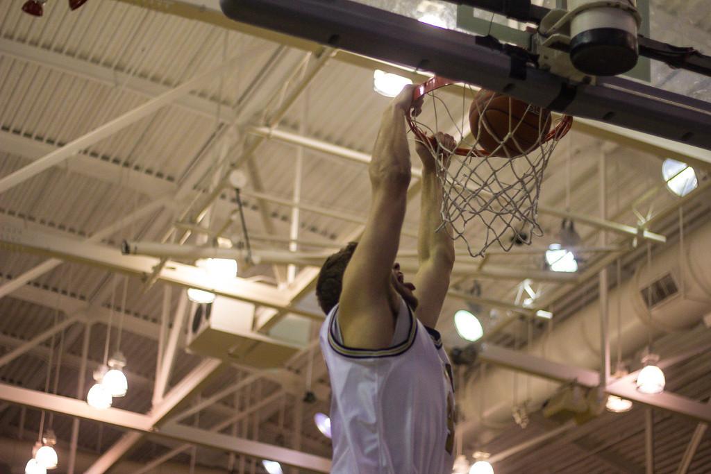Description of . Petros makes a dunk. Photos by Dylan Dulberg/The Oakland Press