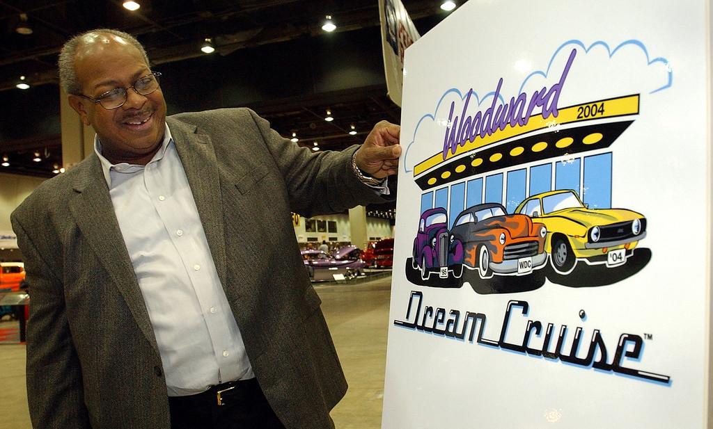 Description of . Pastor Douglas Jones, President, Woodward Dream Cruise, with the 2004 Woodward Dream Cruise logo unveiled at Autorama at Cobo Center in Detroit, Friday February 27, 2004.