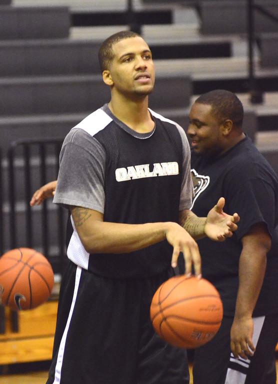 Description of . Oakland University guard Duke Mondy during practice Tuesday.    Tuesday, November 5, 2013.  The Oakland Press/TIM THOMPSON