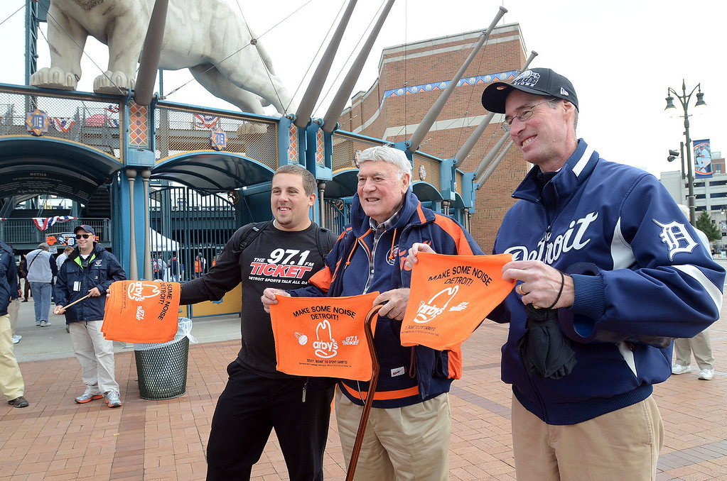 Description of . Fans show off their Tiger Towels before heading into Comerica Park for the start of Game 3 of the ALDS between the Tigers and Oakland A's, Monday October 7, 2013. (Oakland Press Photo:Vaughn Gurganian)
