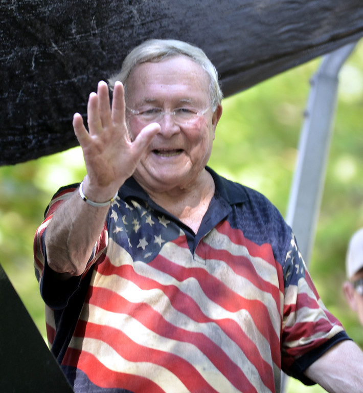 Description of . Oakland County Executive L. Brooks Patterson waves to the crowd during the Clarkston July 4th parade. The Oakland Press/DOUG BAUMAN