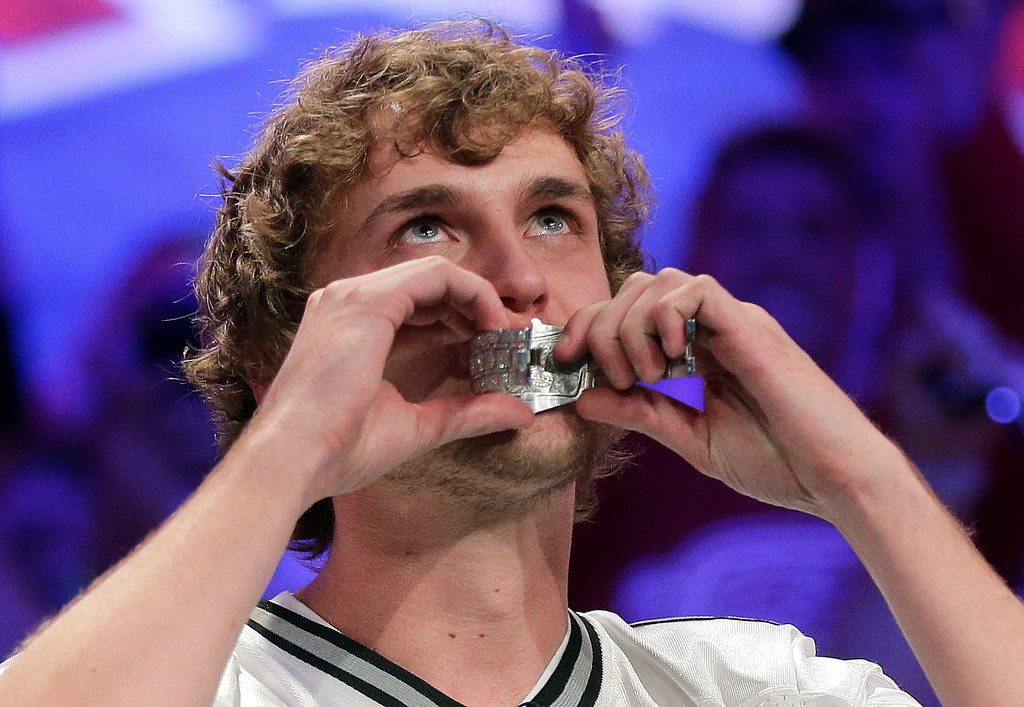 Description of . Ryan Riess kisses the championship bracelet after defeating Jay Farber for the $8.4 million payout in the World Series of Poker Final Table, Tuesday, Nov. 5, 2013, in Las Vegas. (AP Photo/Julie Jacobson)