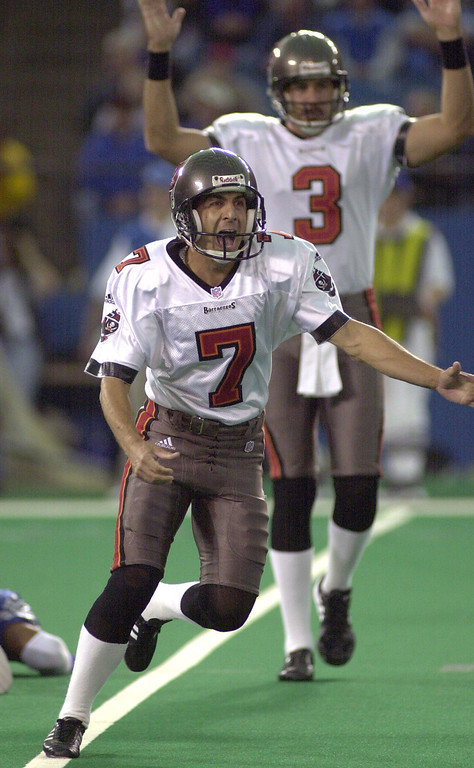 . Tampa Bay kicker Martin Gramatica and holder Mark Royals celebrate his 35-yard field goal with four seconds left to play in the game to beat the Detroit Lions 20-17 at the Pontiac Silverdome Sunday.