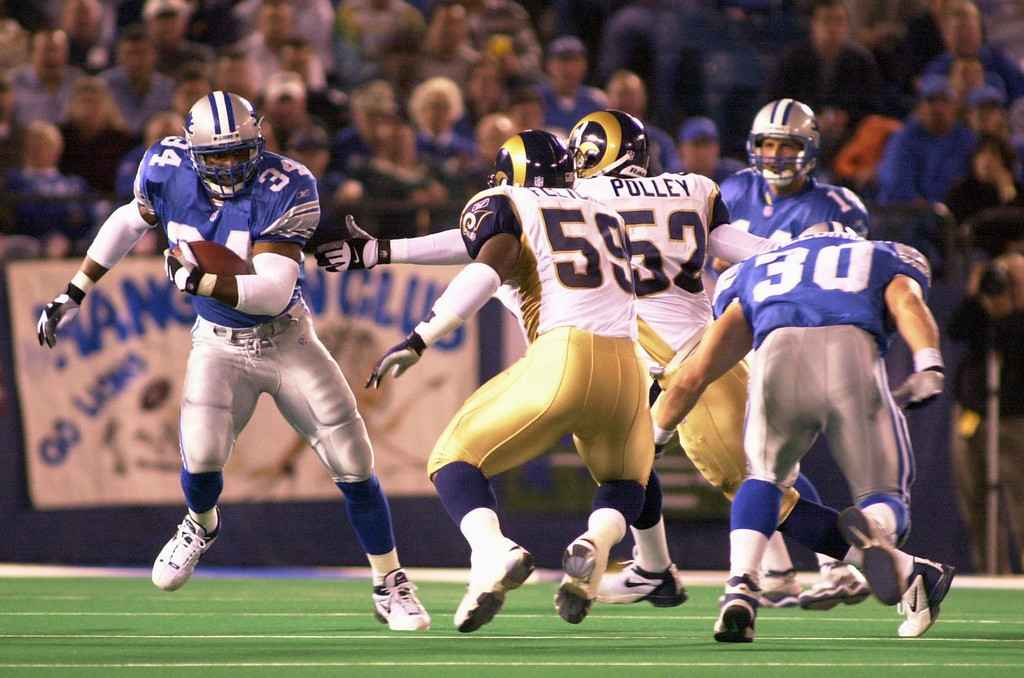 . Detroit Lions running back James Jones (34) out runs two St. Louis Rams players in the during first half action against the St. Louis Rams played at the Pontiac Silverdome in Pontiac, Mich., Monday, October 8, 2001.