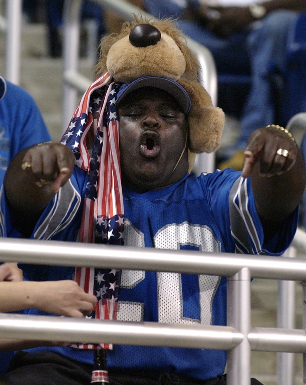 . Joe Sanders (no relation) of Detroit cheers on the team wearing a stuffed lion on his head during the first quarter of the Detroit Lions 34-22 loss to the Pittsburgh Steelers at Ford Field Sat. Aug. 24, 2002.