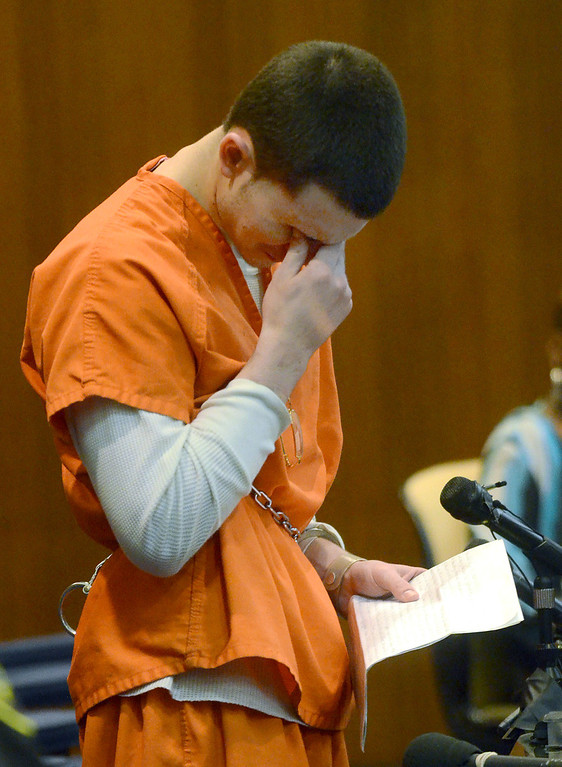 Description of . Mitchell Young wipes away tears while reading a lengthy statement before being sentenced to life with no parole for the beating death of Robert Cipriano, in the courtroom of Oakland County Circuit Court Judge Shalina Kumar,  Wednesday July 24, 2013. (Oakland Press Photo:Vaughn Gurganian)
