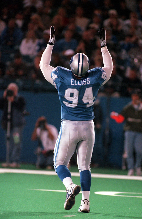 . Luther Elliss (94) of the Detroit Lions gives thanks after sacking Chicago Bears quarterback Steve Stenstrom in the first quarter during Sunday night\'s game at the Pontiac Silverdome.