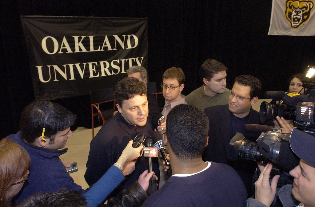 Description of . Oakland University's NCAA tournament bound basketball team's coach Greg Kampe gets a lot of attention form the media after it was announced who they will play in the NCAA tournament.
