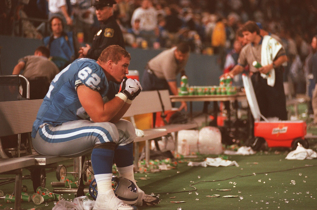 . Tony Semple (62) of the Detroit Lions sits on the bench after the overtime loss to the New York Giants at the Pontiac Silverdome.