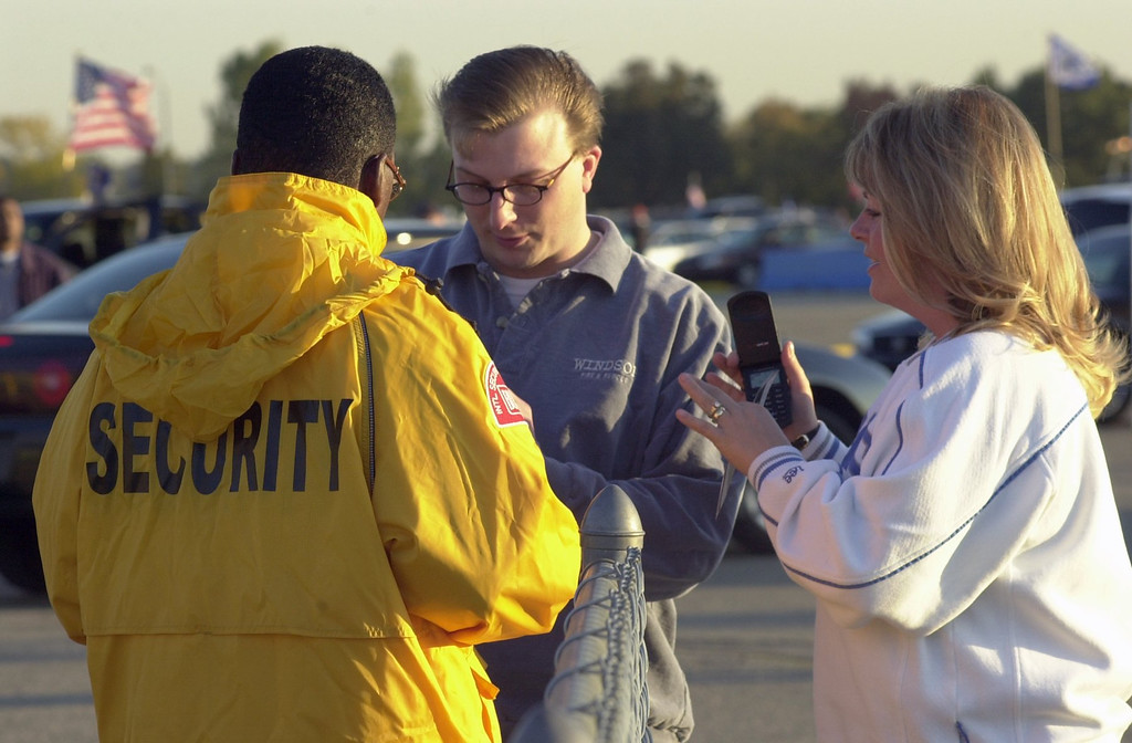 . Chris Hunt of Farmington Hills along with his wife Kristi have their cell phone and bags checked before enterning the Pontiac Silverdome prior to the start of the Detroit Lions home game against the St. Louis Rams on Monday Night Football. Security around the country has increased at all football stadiums due to the terrorist attack on Sept. 11, 2001.