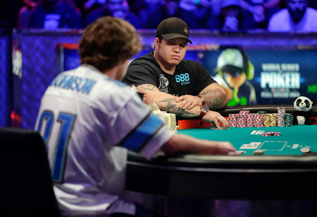 Description of . Jay Farber, right, waits for Ryan Riess' decision to call or fold during the World Series of Poker final table, Tuesday, Nov. 5, 2013, in Las Vegas. (AP Photo/Julie Jacobson)