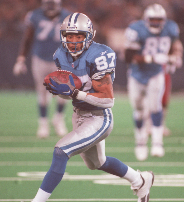 . Detroit Lions wide receiver Johnnie Morton (#87) catches a pass and takes it the one yard line for a 41 yard play agaisnt the Arizona Cardinals during fourth quarter action at the Pontiac Silverdome.