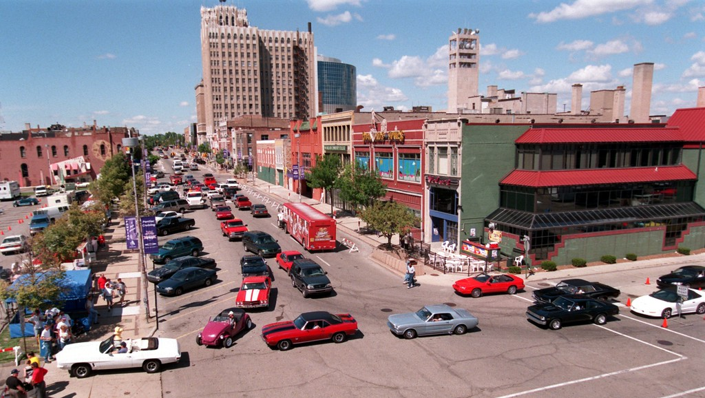 . Cars wait in line on Saginaw Street Friday to get into the parking lot outside the Phoenix Center.