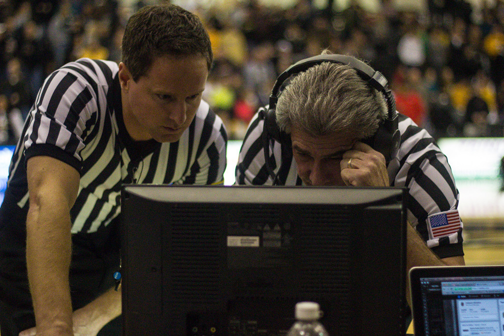 Description of . After the final three-pointer by Mondy, the referees confer to clarify the playcall. Photos by Dylan Dulberg/The Oakland Press