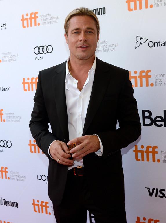Description of . Brad Pitt arrives at the premiere for