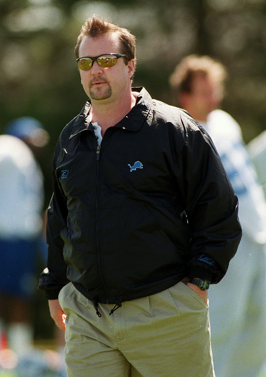 . Detroit Lions head coach Marty Mornhinweg watches the Lions morning session of mini camp, Friday, April 27, 2001, at the Lions practice facility in Pontiac, Mich.