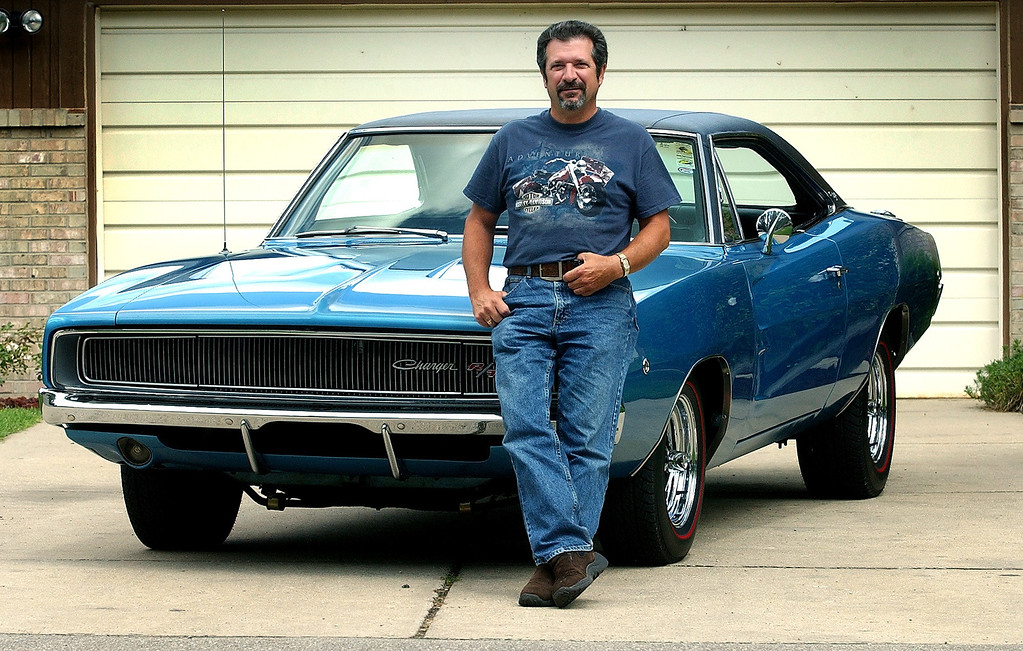 Description of . Jim Burtner with his 1968 Dodge Charger in front of his Farmington Hills home, Thursday August 5, 2004.