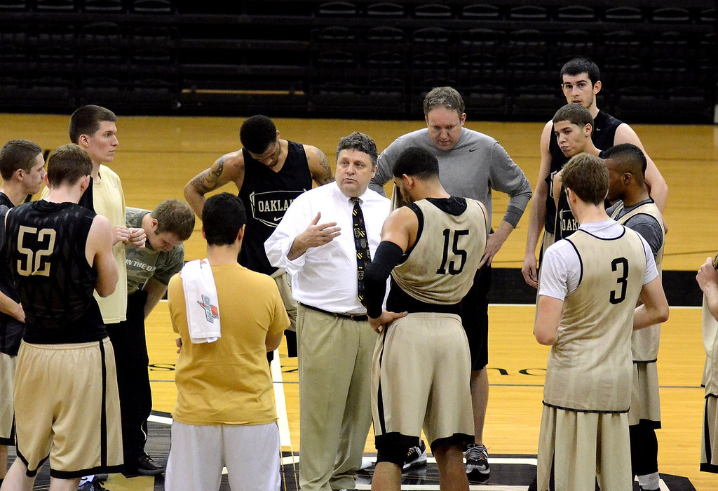 Description of . ***WITH VIDEO***   Oakland University basketball's Head Coach Greg Kampe talks to his player during practice for the upcoming Summit League Tournament.   Thursday, March 1, 2012.  The Oakland Press/TIM THOMPSON