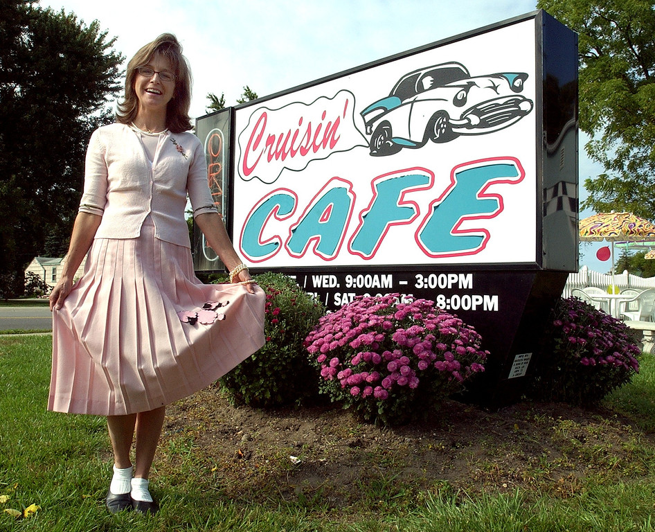 . Co-owner Cynthia Kherkher with her poodle skirt in front of the Cruisin\' Cafe in Waterford Twp. Thursday August 19, 2004. The restaurant is offering a $1 special menu this week because of the Woodward Dream Cruise.