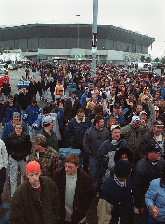 Description of . Fans pour out of the Pontiac Silverdome after the Lions/Cowboys game Sunday January 6, 2002. The Lions beat the Cowboys 15-10, ending the season with a 2-14 record at their last game they'll play at the Silverdome before moving to Ford Field.