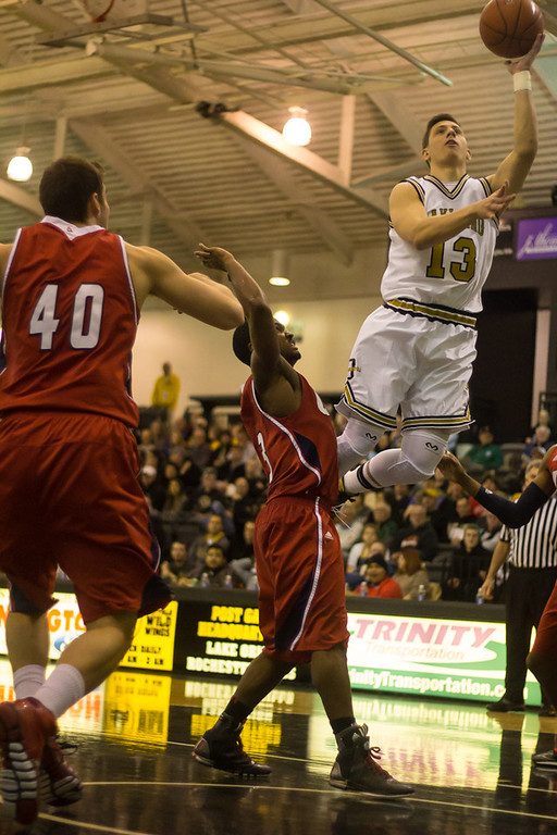 Description of . Baenzinger goes for the lay-up. Photos by Dylan Dulberg/The Oakland Press