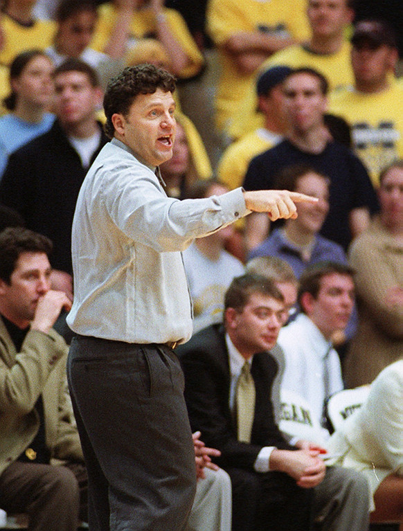 Description of . File art from the Oakland University vs Michigan game 11-16-01.  Oalkand University head basketball coach  Greg Kampe.
