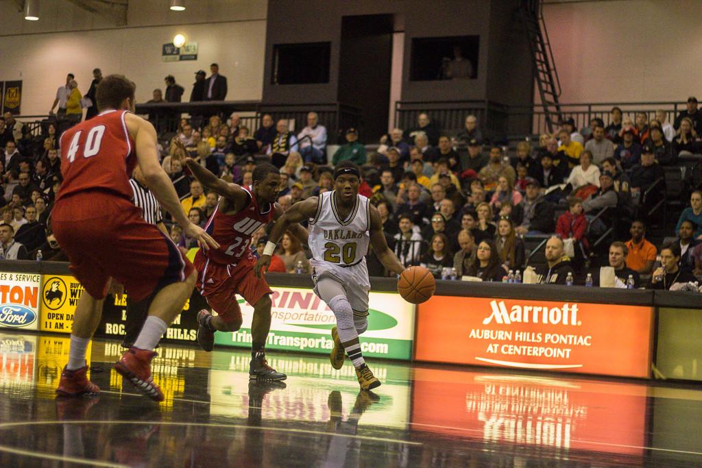 Description of . Felder moves the ball towards the basket. Photos by Dylan Dulberg/The Oakland Press