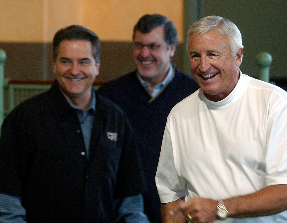 . Former Detroit Lions head coach (f. left) Steve Mariucci, Chris Foskett, of the CitiGroup and Frank Krauser, President & CEO of NFL Alumni, share a laugh during the NFL Alumni Classic Bocce Tournament at Palazzo di Bocce in Orion Twp., Fridaay February 3, 2006.