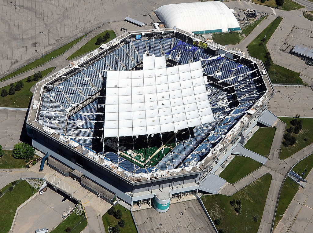 Description of . An aerial view of the shredded roof of the Pontiac Silverdome, pictured Tuesday June 18, 2013. (Oakland Press Photo:Vaughn Gurganian)