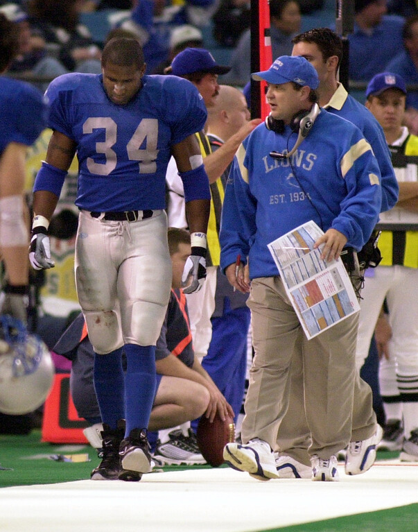 . Detroit Lions running back James Stewart (left, #34) hobbles on the sideline after getting injured against the Green Bay Packers, as head coach Marty Mornhinweg talks with him, Thursday, November 22, 2001, at the Silverdome in Pontiac, Mich.