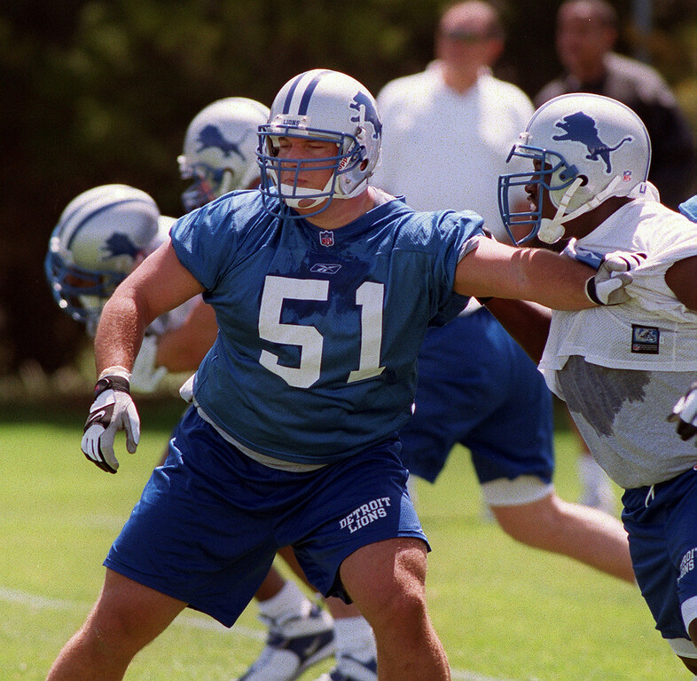 . Detroit Lions second round draft choice Dominic Raiola (left, #51) blocks teammate Toby Golliday (#69) during the Lions morning session of mini camp, Friday, April 27, 2001, at the Lions practice facility in Pontiac, Mich.