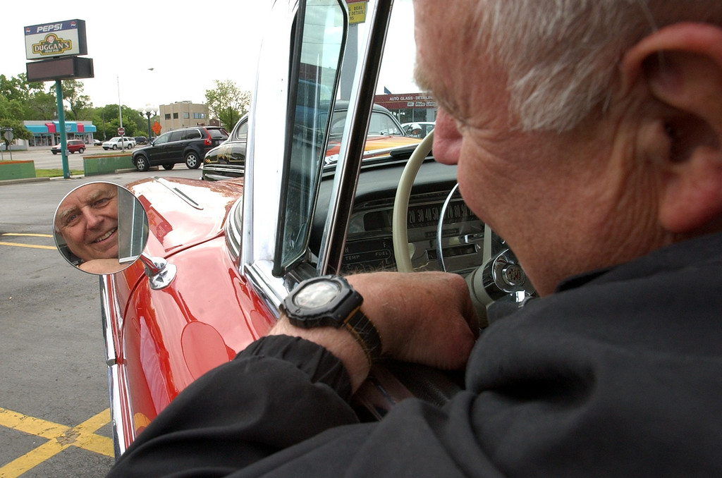 Description of . Paul Scharfenberg, of Detroit, is all ready to cruise in his 1958 Cadillac Coupe, while at the 2005 Woodward Dream Cruise kick off party at Duggan\'s Irish Pub in Royal Oak, Wednesday May 25, 2005.