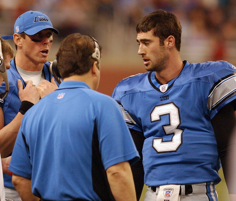 . Detroit Lions QB Joey Harrington (3) and backup Mike McMahon, top left, chat with coach Steve Mariucci  during a timeout on Sunday during the final home game of the 2004 season at Ford Field in Detroit against the Chicago Bears.