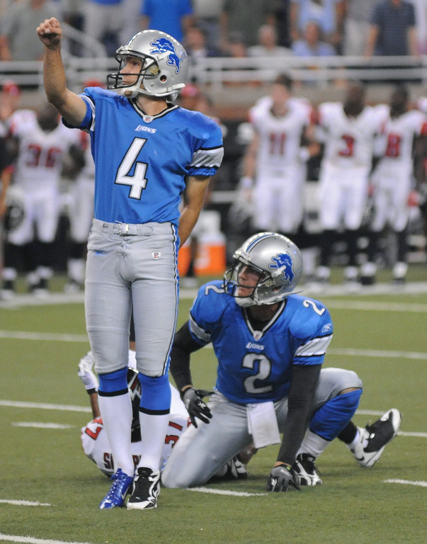 . Detroit Lions kicker Jason Hanson kicks the game winning field goal to beat the Atlanta Falcons on the last play of the game, Saturday, August 15, 2009, in Detroit, Mich.  At right is holder Nick Harris.  The Lions beat the Falcons, 27-26.  (The Oakland Press/Jose Juarez)