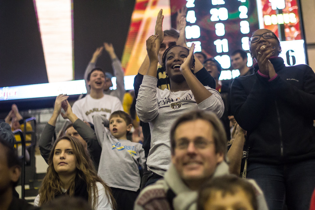 Description of . Fans applaud as OU takes the lead. Photo by Dylan Dulberg/The Oakland Press