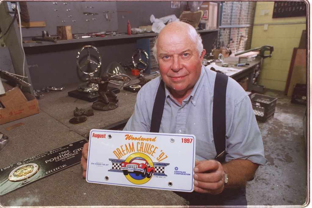 Description of . don sommer created this commemorative license plate for the woodward dream cruise coming up on aug. 16th, seen here in his auto part reseration shop in clawson