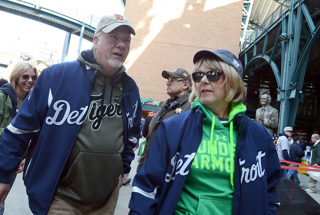 Description of . Don and Sue McGraw, of Springfield Twp., make their way to their seats for the Tigers home opener game against Kansas City, pictured Monday March 31, 2014. This is Don's 43rd Opening Day he's attended for the Tigers. (Vaughn Gurganian-The Oakland Press)