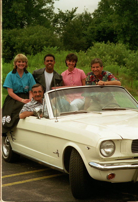 Description of . Channel 7 Dream Cruise Special. (top) Mary Conway, Chris Lawrence, JoAnne Pertan, and Guy Gordon. (Seated)is Dick Purtan in this 1966 Mustang Convertable.