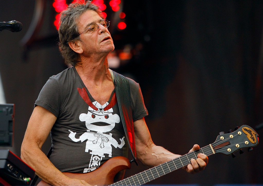 Description of . FILE - In this Sunday, Aug. 9, 2009 file photo, Lou Reed performs at the Lollapalooza music festival, in Chicago. Punk-poet, rock legend Lou Reed is dead of a liver-related ailment, his literary agen said Sunday, Oct. 27, 2013. He was 71.  (AP Photo/John Smierciak, File)