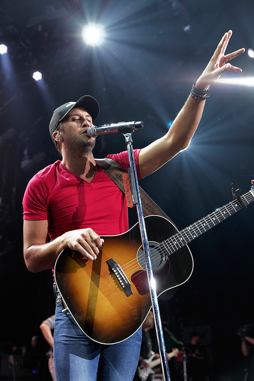 Description of . Luke Bryan performs June 18, 2014, in the first of two concerts at DTE Energy Music Theatre. Photo by Ken Settle
