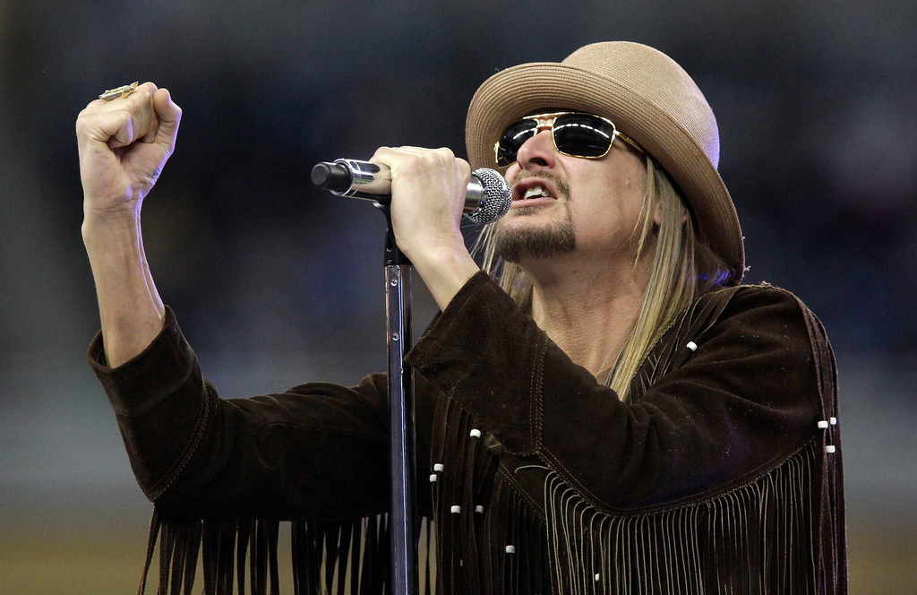 . Musician Kid Rock performs during the half time ceremony at the NFL football game between the Detroit Lions and the New England Patriots, Thursday, Nov. 25, 2010, at Ford Field in Detroit. (AP Photo/Carlos Osorio)